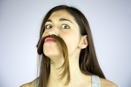 funny girl making mustache of her long hair Stock Photo - 13133620