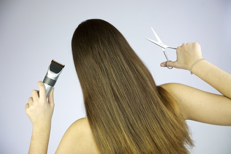 Girl with scissors and razor photo
