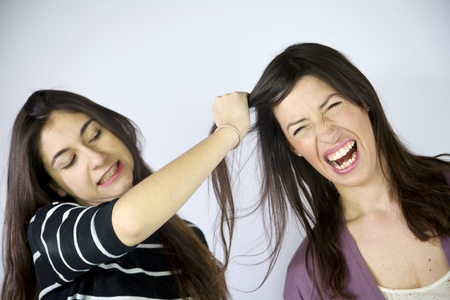 girl pulling hair angry fighting photo