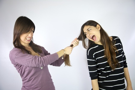 girl pulling the long hair of her friend photo