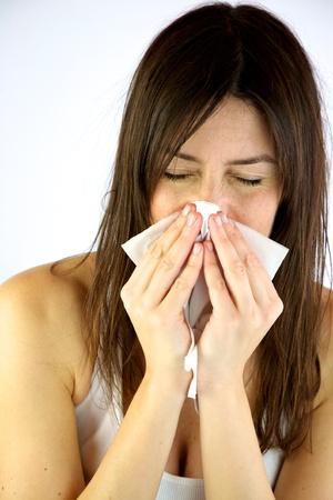Sick girl sneezes strong photo
