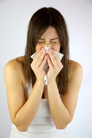 Very sick girl sneezing hard