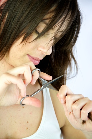 Female model cuts her own long hair Stock Photo - 13133634