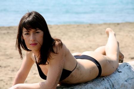woman in bikini on sea laying on a tree Stock Photo - 13133662