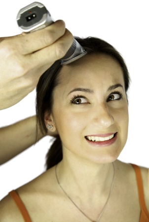 Female model very scared about her long hair beeing buzzed Stock Photo - 13644307