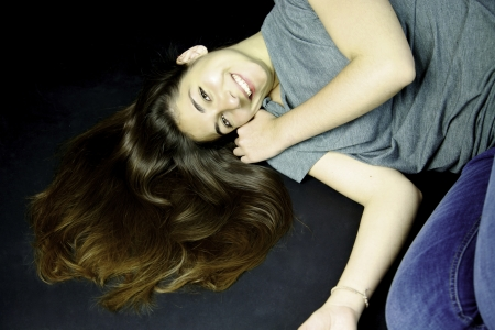 Girl with long hair on the ground smiling Stock Photo - 13647265