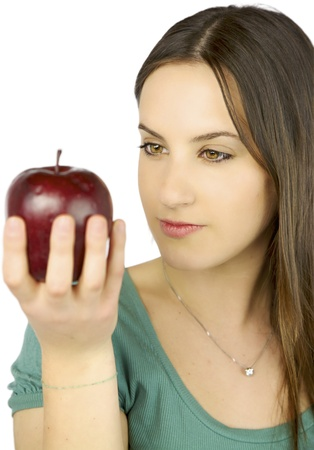 Young female model observing intense a big red apple photo