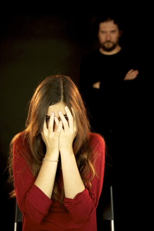 Young woman scared of bad black man Stock Photo - 13757353