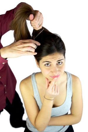 Hairdresser cutting very long hair while female model is doubtful Stock Photo - 13851018