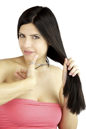 Woman with big green eyes ready to cut her long black hair smiling Stock Photo - 14014069