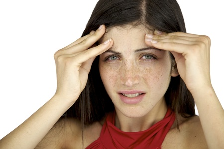 Beautiful female model with freckles and blue eyes suffering headache Stock Photo - 14403101