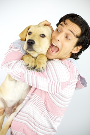 happy young male model hugging puppy labrador dog  photo
