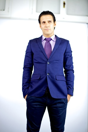 attractive young cool businessman thinking standing photo