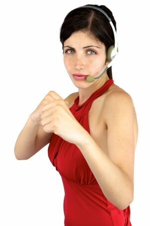 Sexy call center girl with fist up ready to punch and fight photo