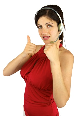 Good looking woman with freckles and green eyes with headset and thumbs up photo