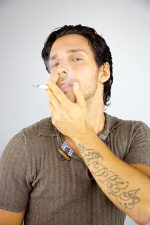 Cool man smoking cigarette enjoying happy Stock Photo - 14893270