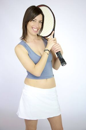 Sexy tennis player woman posing with racquet smiling photo