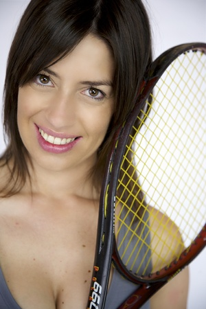 Smiling femal model with tennis racquet photo