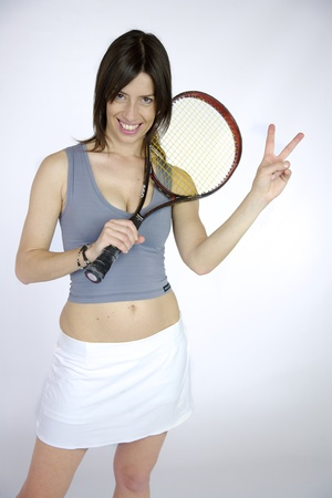 femal: Happy beautiful femal model with v sign after won tennis match Stock Photo