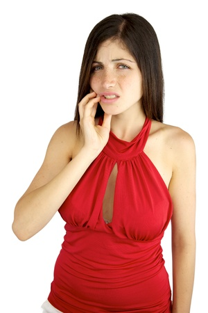 Girl with hand on her cheek because of bad tooth ache pain