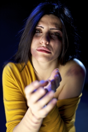 Desperate beautiful woman scared after violence Stock Photo - 15574339