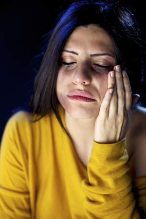 Abused and  hit woman with violence crying lonely Stock Photo - 15574341