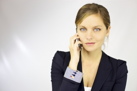 Gorgeous business woman talking on the phone happy Stock Photo - 15620075