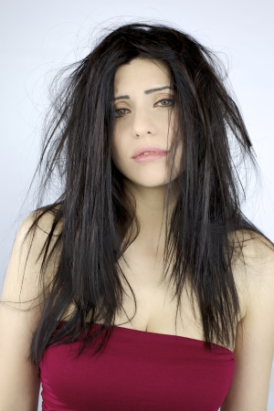 Sad depressed beautiful woman about her messy hair
