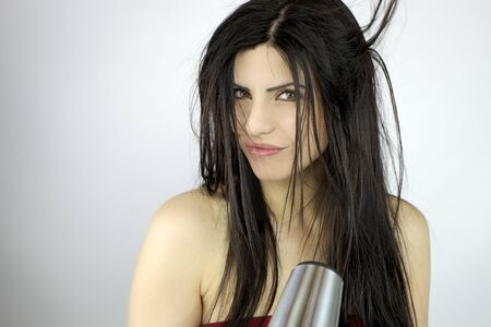 Gorgeous female model blow dry long black beautiful hair photo