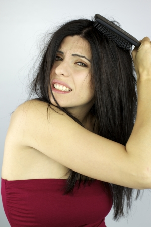 bad hair day: Gorgeous female model not able to style her long black hair