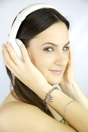 Cute young woman happy listening music with headphones photo