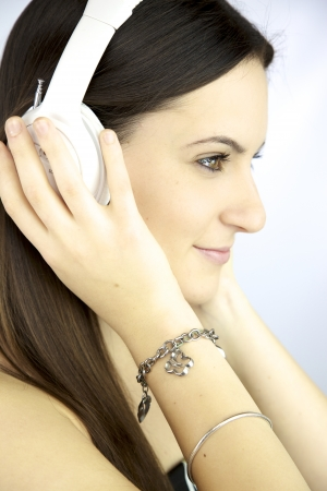 Cute girl listening music with headphones photo