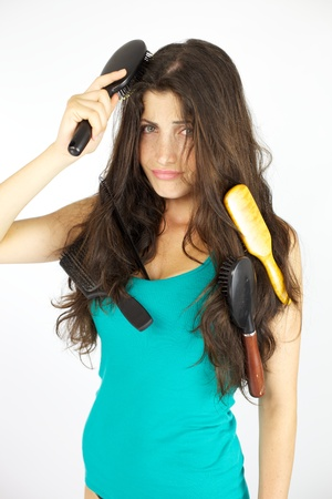 Woman with wavy long hair not able to brush them in the morning photo