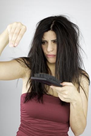 Angry beautiful woman loosing hair photo