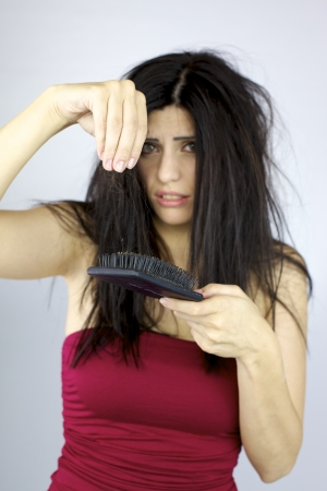 Hair loss problem sad and terryfied woman photo