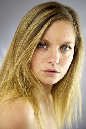 Portrait of beautiful woman without makeup and messy hair photo