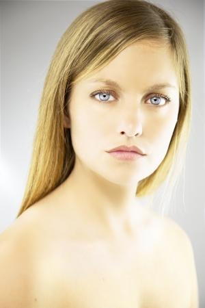 Sad gorgeous blond young woman portrait in studio beauty shot