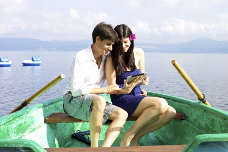 Beautiful brunette and handsome man on boat in italian lake