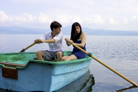 Uncapable woman making husband angry on boat photo