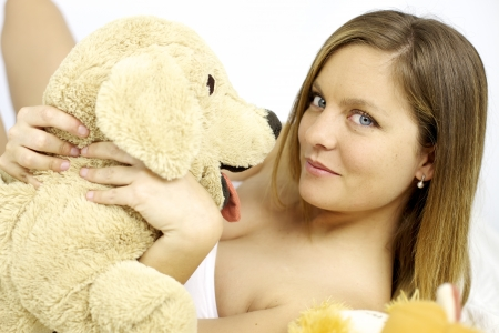 Good looking female model playing with stuffed animal photo