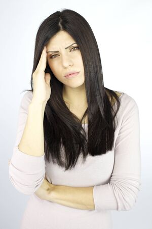 suffering: sad woman suffering pain migraine Stock Photo