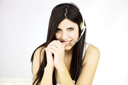 Fantastic female model with gorgeous smile with headset isolated photo