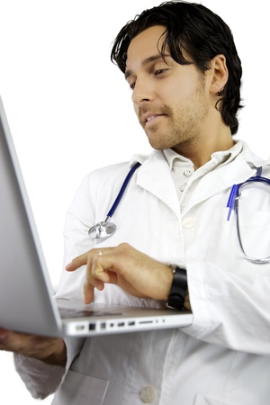Good looking male doctor serious working  photo