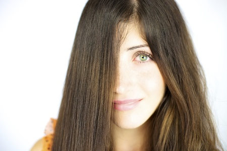 Smiling beauty with long straightened hair and wavy hair photo