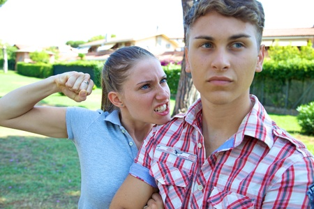 Good looking young blonde girl willing to punch boyfriend photo