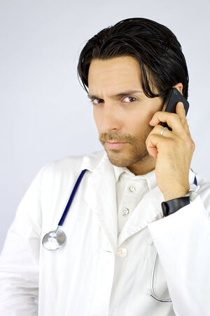 Serious doctor talking  photo