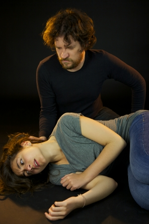 Man abusing of woman creating sadness and despair photo