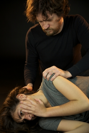 Strong bad violent man looking his abused wife photo
