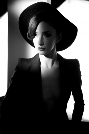 Amazing portrait of female model posing with hat and jacket black and white photo