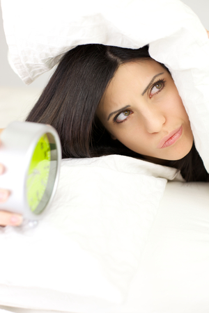 Woman angry with alarm clock